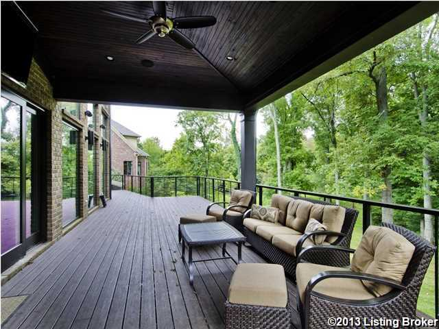 The deck sprawls the length of the home, looking out over the woods.