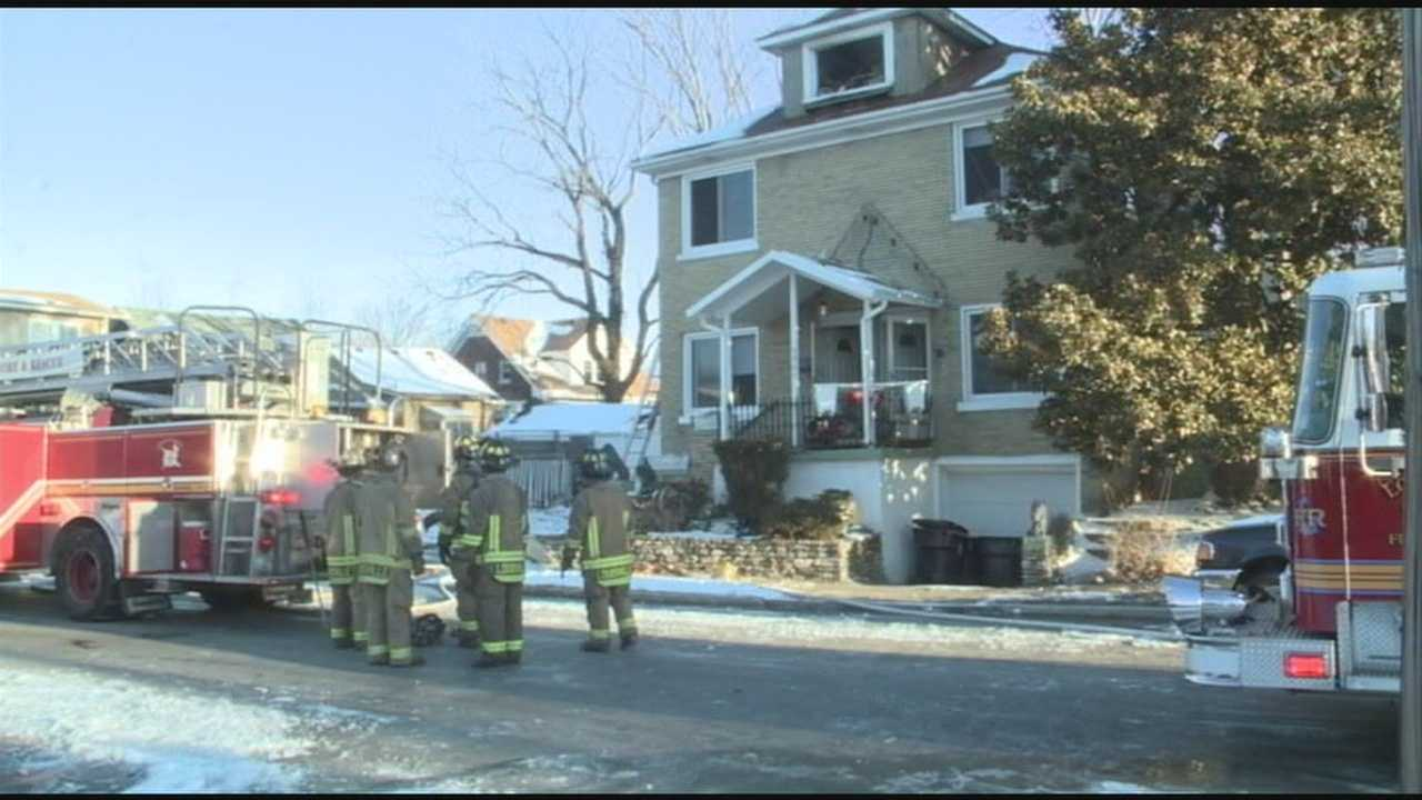 A stranger came to the rescue during an early morning house fire on Larkwood Avenue in west Louisville.
