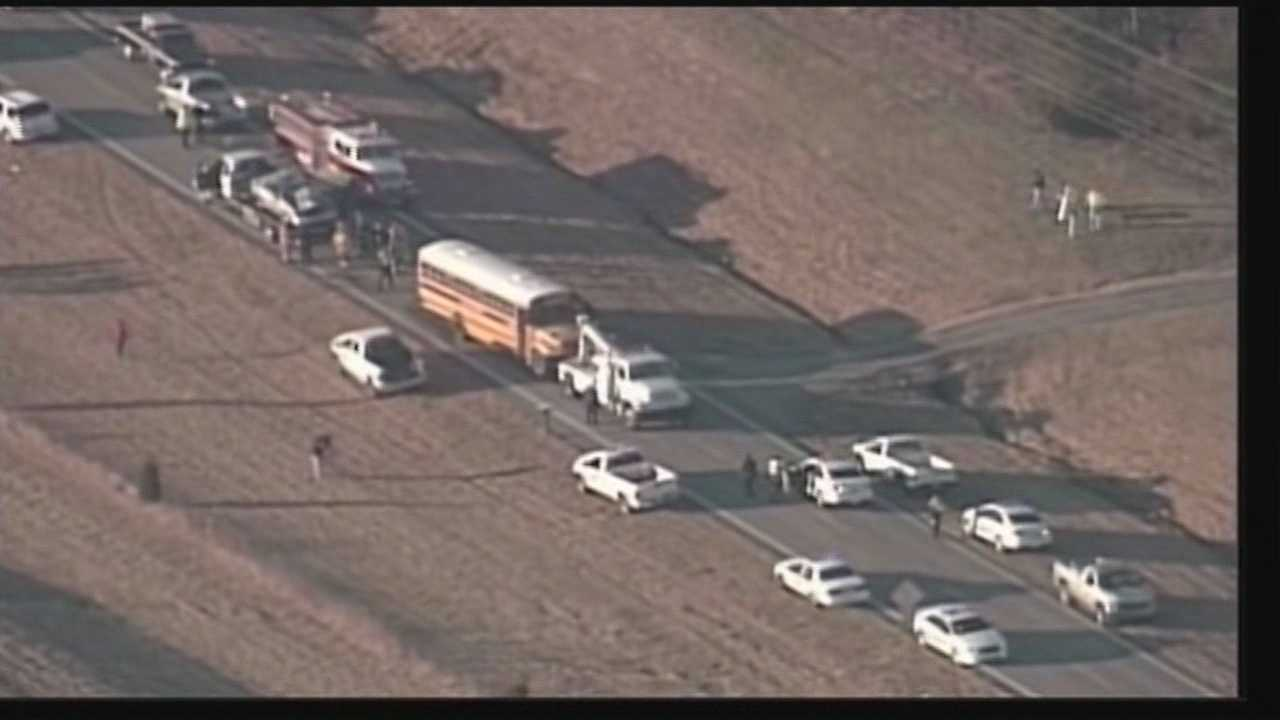 An 86-year-old man is dead after a crash involving a school bus in Bullitt County.