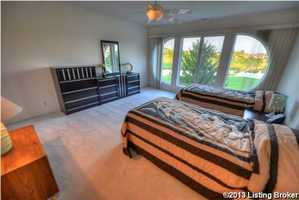 This bedroom, also features golf course views, without the luxury of the balcony.