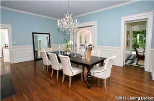 An antique chandelier illuminated the pale blue walls in this generous dining room for formal gatherings.