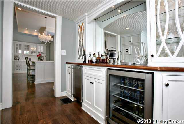The butler pantry is right outside the kitchen area.