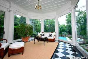 Now this is an elegant sun room!