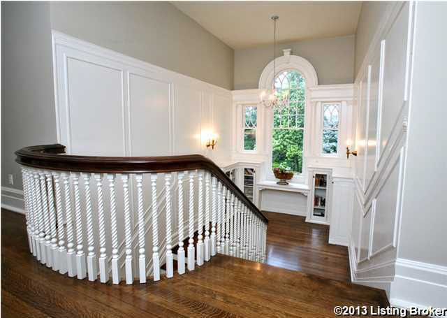 Treatments along the stairway include, built-in shelving.