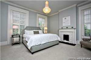 The master bedroom features a sophisticated style and a personal fireplace.