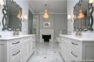 Dual vanities in the master bathroom are opposite of each other.