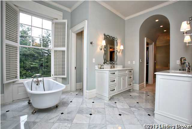 A free-standing spa tub looks perfect on the marble-tile floors.