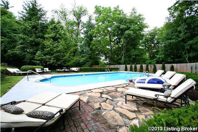 Lush trees provide plenty of privacy around the pool area.