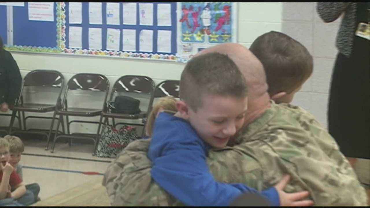 A soldier who just returned home from Afghanistan surprises his children at school.