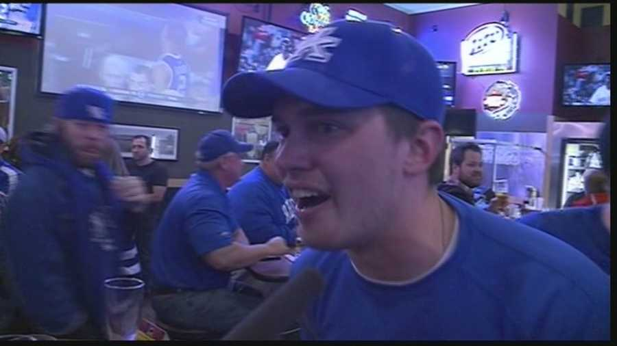 Fans in Louisville celebrate Saturday night's win over Wisconsin.