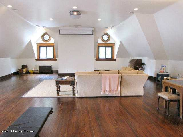 The top floor loft has been converted into a theater room.