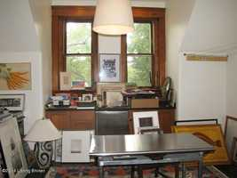 Home office also boasts large windows for natural light.