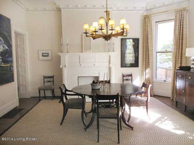 Gracious dining room also has a beautiful fireplace.
