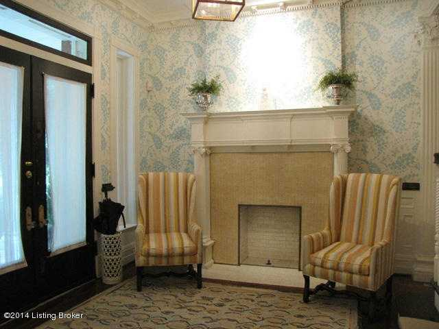 The foyer boasts one of four fireplaces on the first floor.