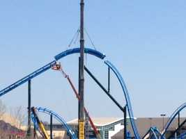 """April 9, 2014: Crews placed the final section of the track on the park's newest and tallest roller coaster, """"Lighting Run."""" (Read more)"""
