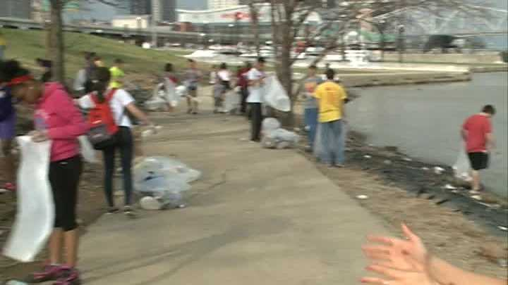 Volunteers were out Sunday cleaning up the mess left behind after Thunder Over Louisville.