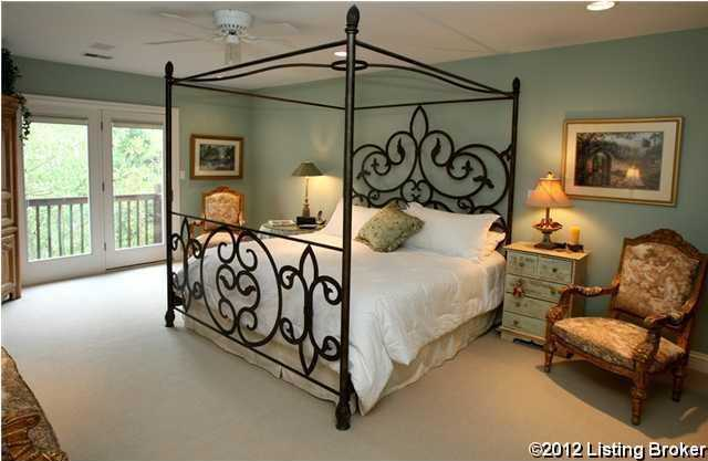 Master bedroom is spacious and includes a private balcony.