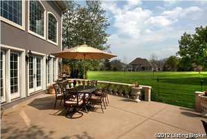 Paved, uncovered patio space has an amazing view of the renowned Lake Forest Country Club golf course.For more information on this property, visit Realtor.com.