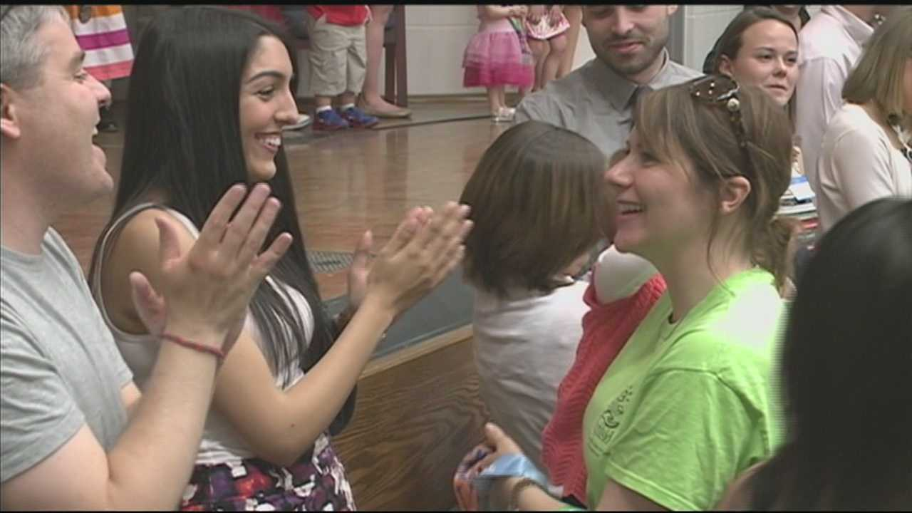 A group of University of Louisville medical students gave their medals from Saturday's Kentucky Derby Festival miniMarathon to children fighting cancer.
