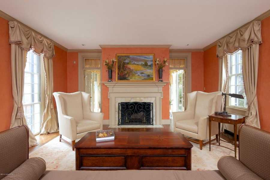The focal point of this living room is the beautiful fireplace.
