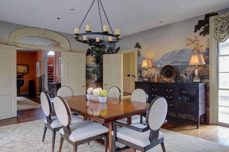The formal dining room is not only beautiful, but spacious.