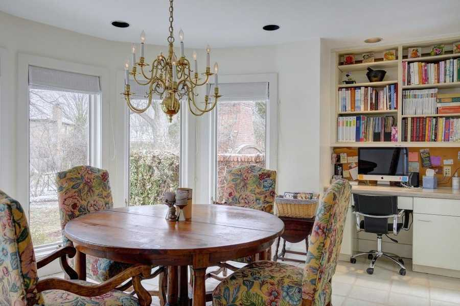 Comfortable breakfast nook features beautiful views and custom desk/shelving unit.