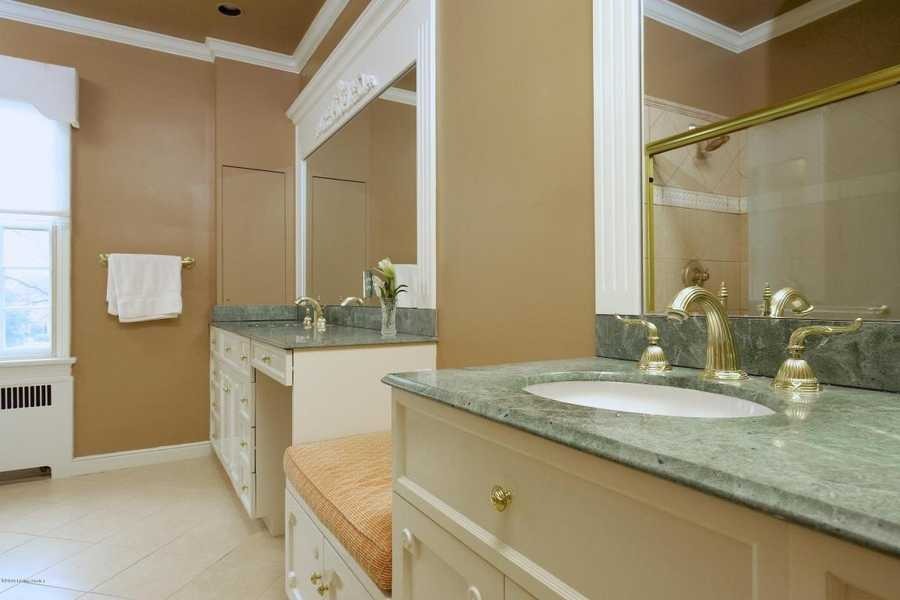 Separate dual vanity sinks in the master bathroom.