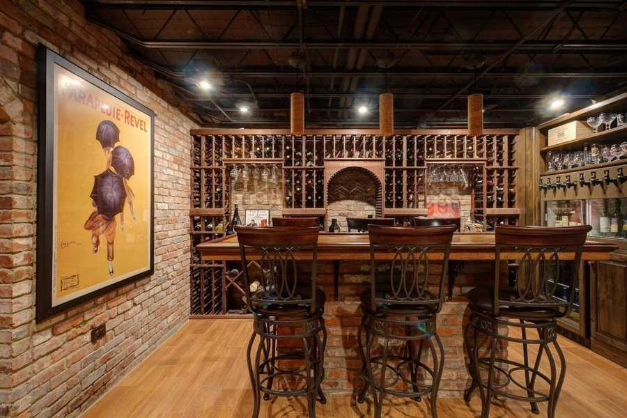 Relax in a spectacular bricked wine bar in the basement.