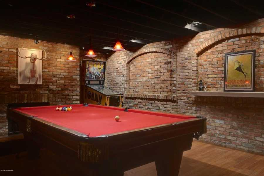 The pool table is accompanied by a vintage arcade game. The finishing touches really make this home what it is. For more information on this home, visit Realtor.com .