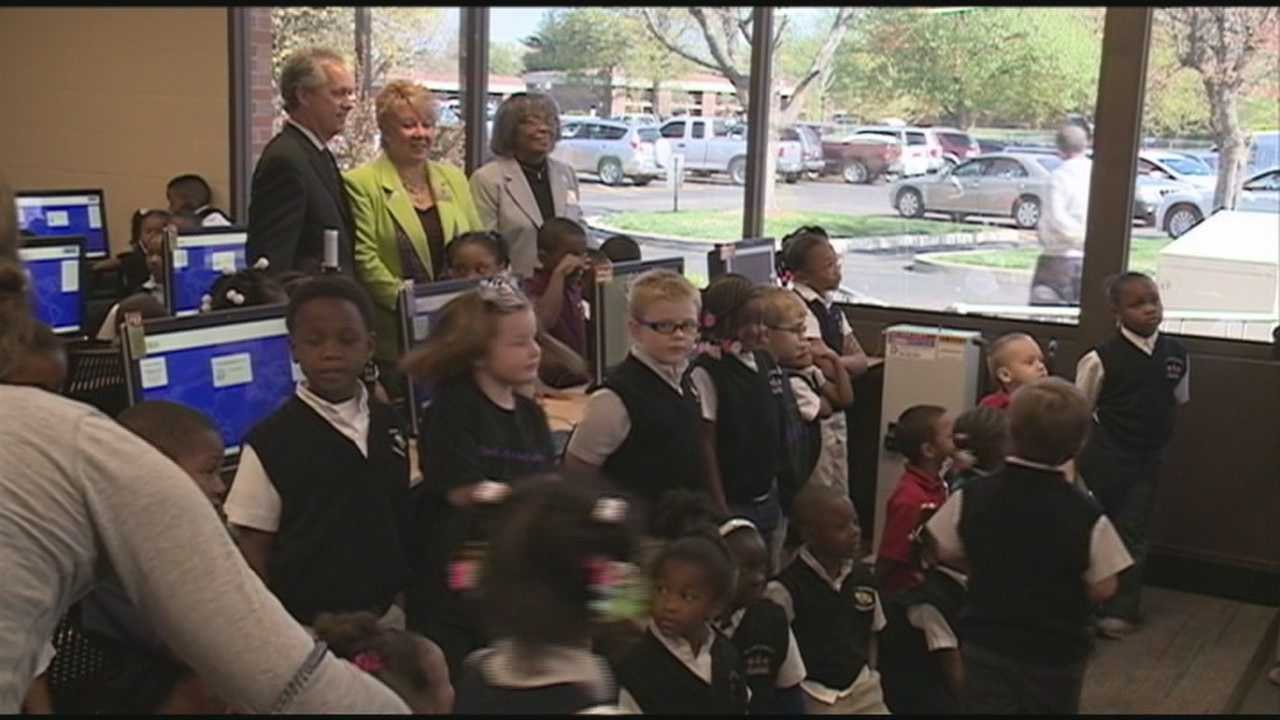 The mayor along with members of the city council and the city of Shively board introduce the newly renovated Shively Library to dozens of onlookers Wednesday.