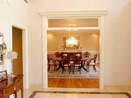 Immediately to your right, you'll see a beautiful formal dining room.