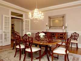 The formal dining room also includes a crystal chandelier.