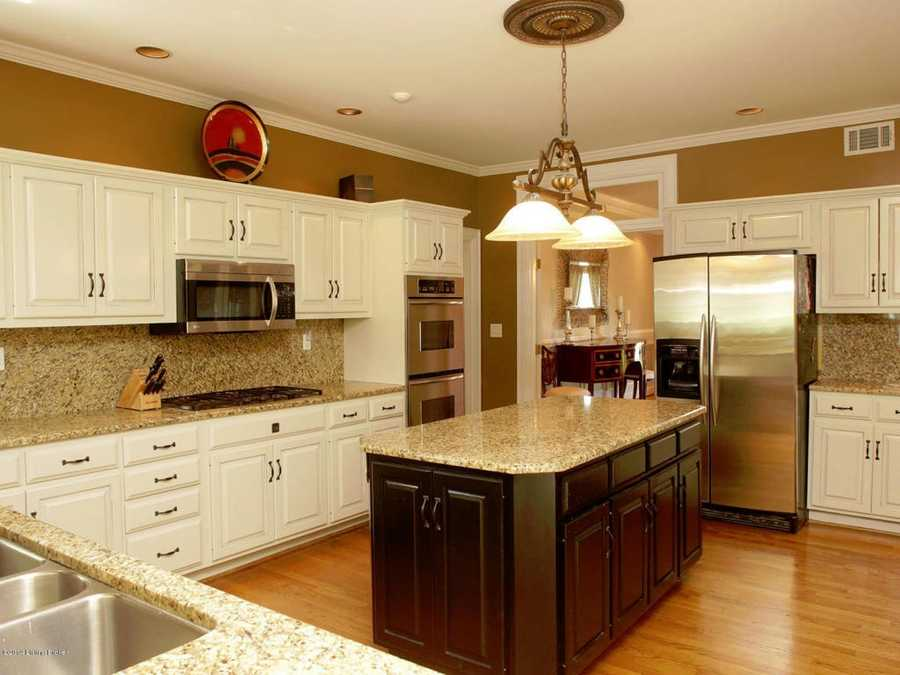 The kitchen boasts hardwood floors, granite counter-tops and backsplash, and a large center island.