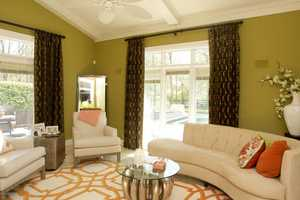 Sunlight illuminates bright, bold colors in the family room.
