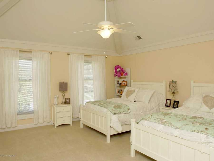 This beautiful guest suite is features a beautiful vaulted ceiling.