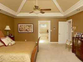 En suite master bedroom is as private as it is luxurious.
