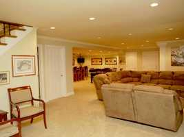 Perfectly refinished basement is a comfortable living space.