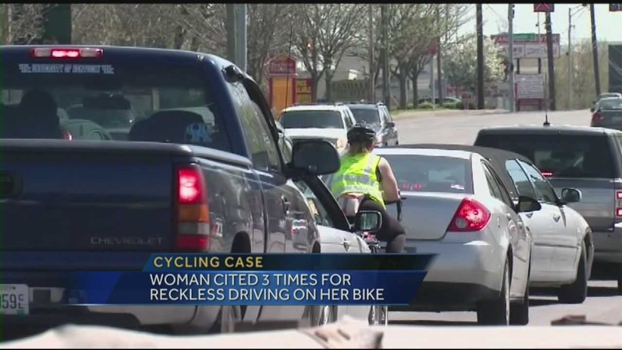A woman is taking on a local police force after being cited three times for reckless driving on her bike.