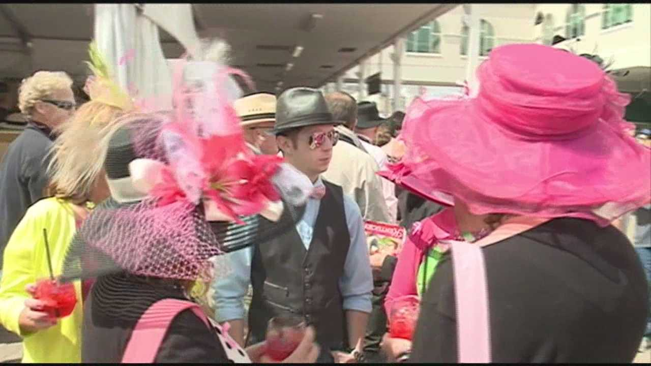 Oaks fans packed Churchill Downs in pink on Oaks Day for breast cancer awareness.