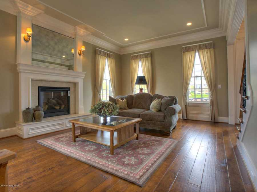 Formal living room features a fireplace and beautiful reconstructed mantle.