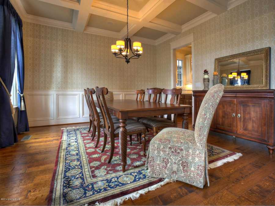 Dining room features a spectacular, wood-paneled ceiling.