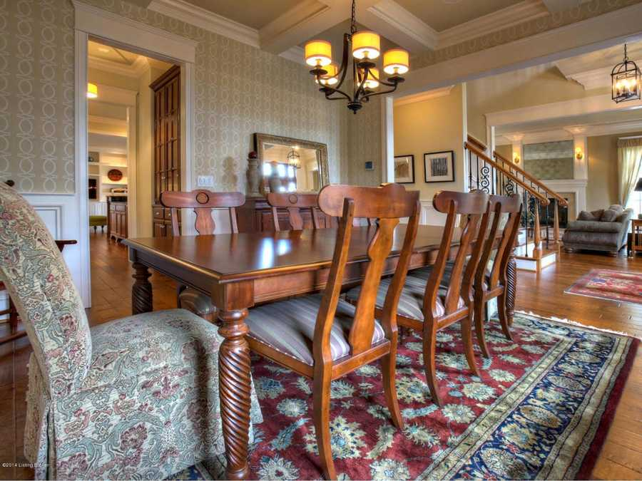 The dining room features seating for eight and two-comfy end seats.