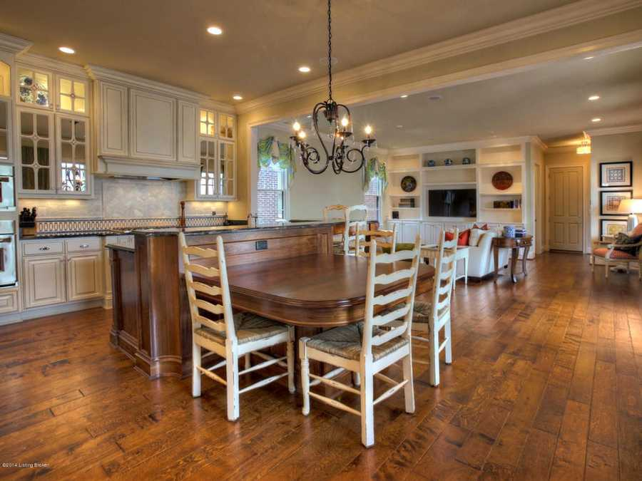 The butler's pantry leads you to the beautiful kitchen, which features an abundance of custom cabinets and cozy hearth room.