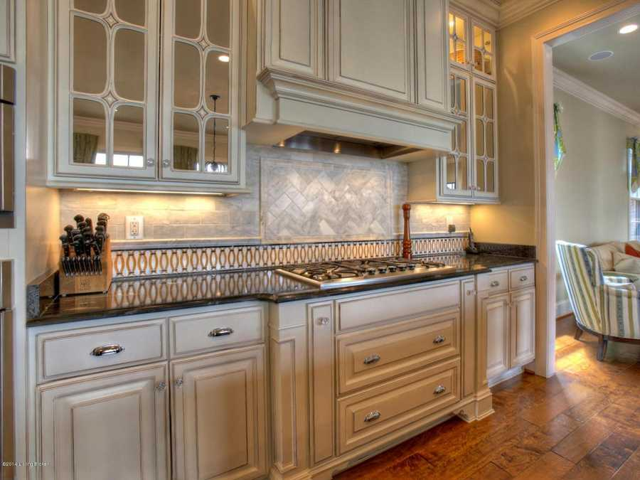 Mirror panels in the cabinets compliment the marble backsplash and counter tops.