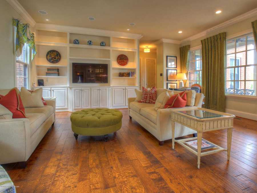 The family room is brightened by large bordering windows and recessed lighting.