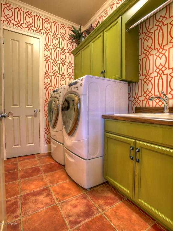Bold and fun wallpaper in the laundry room.