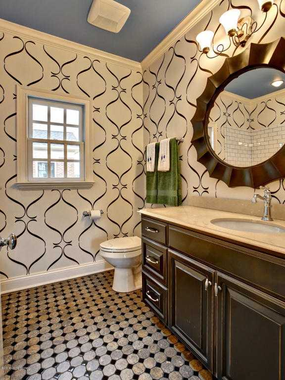 Wallpaper was also used in this bathroom.