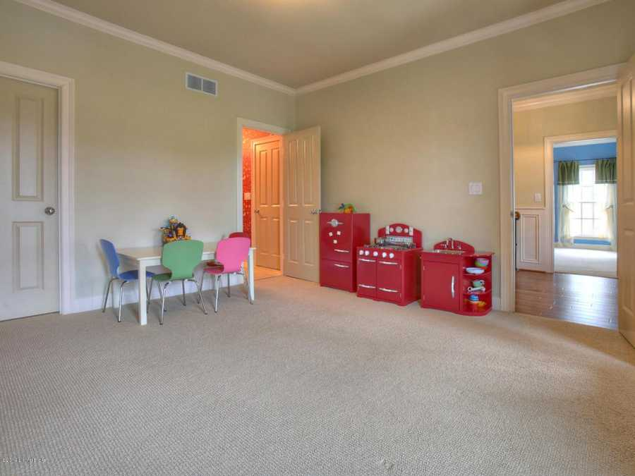Across the hall from the children's room is a spacious play room.