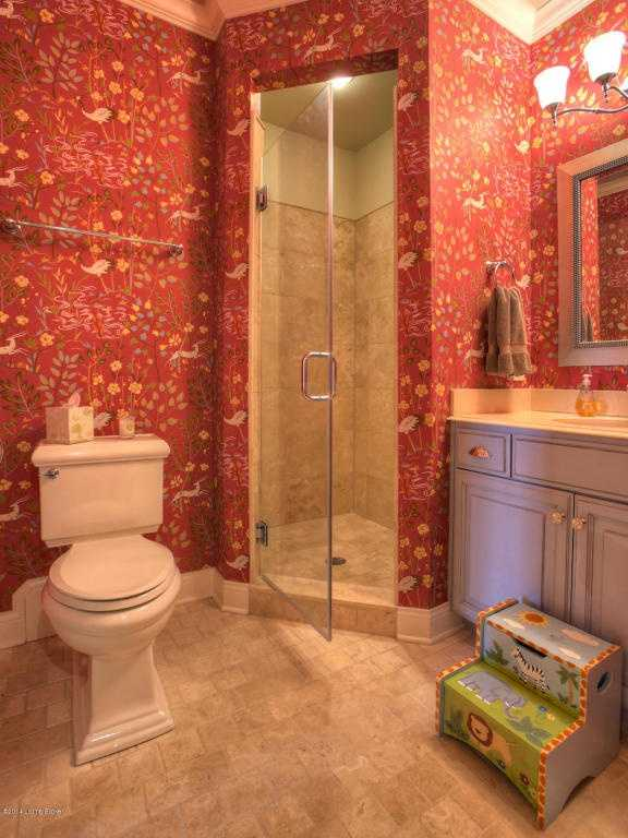 This full bathroom features a quaint step-in shower.