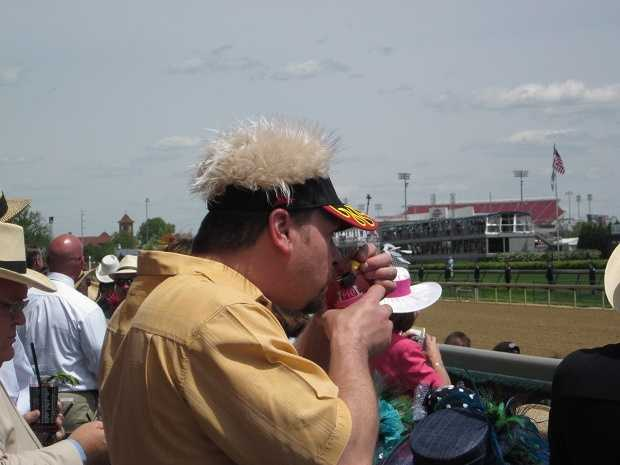 In lieu of a hat, my track neighbor opted for fake hair instead.